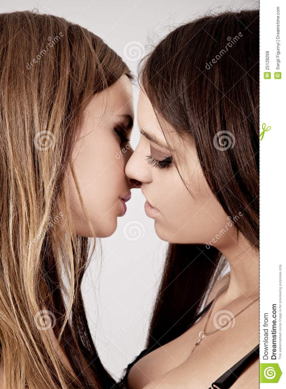 Two Young Attractive Lesbians Kissing