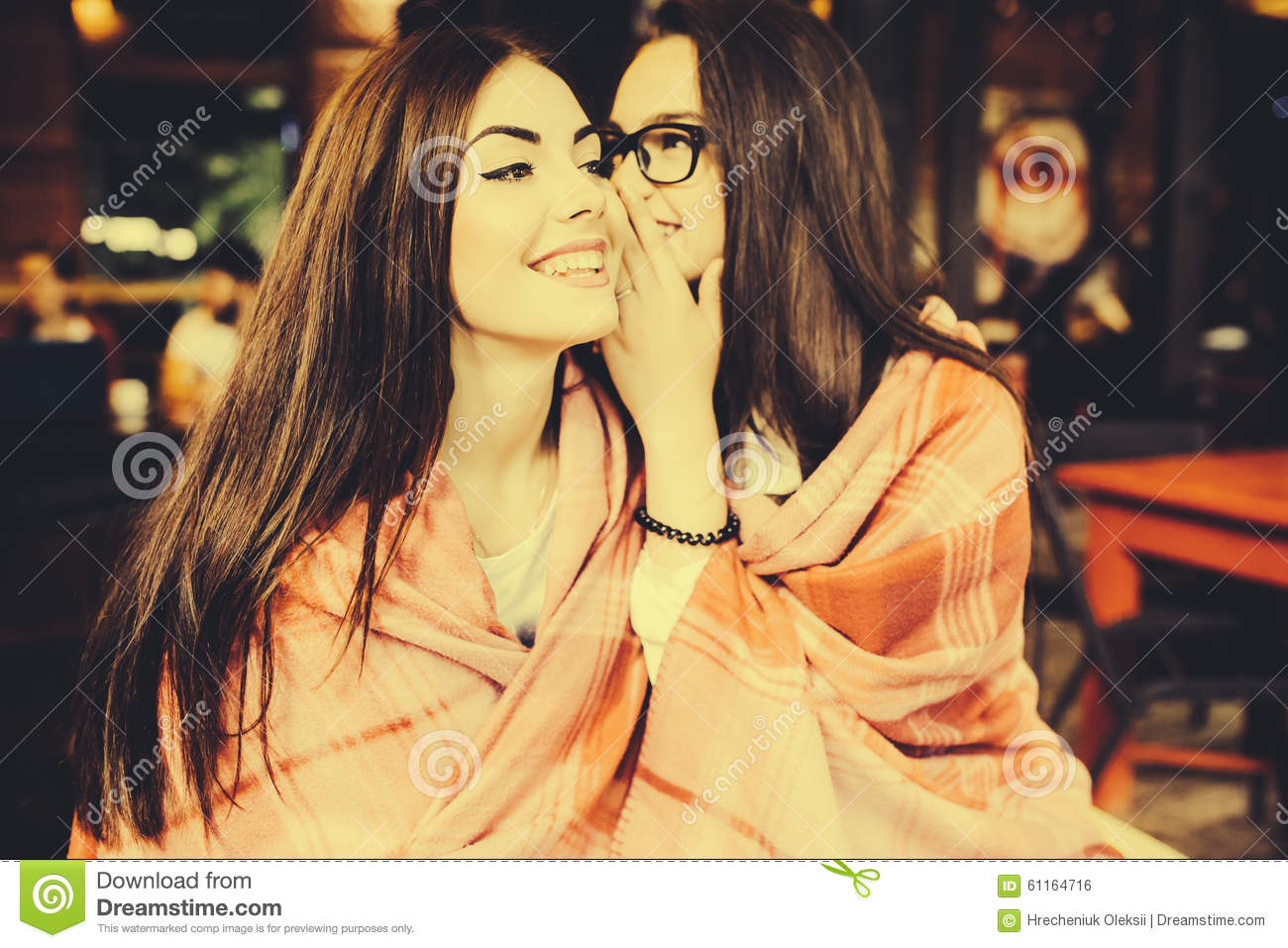 Two Young And Beautiful Girls Share Secrets Stock Photo - Image 61164716-4056