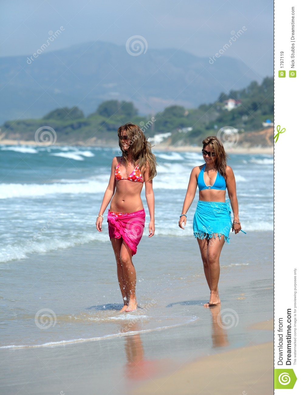 Woman walking on a beach royalty - Beach Beautiful Fit Holiday Sunny Tanned Vacation Walking Women