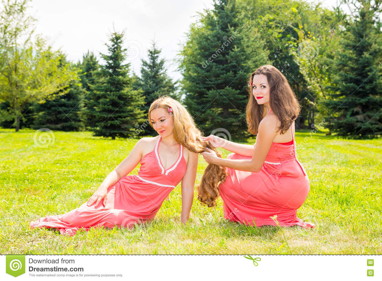 Two young beautiful woman with long hair and outdoor