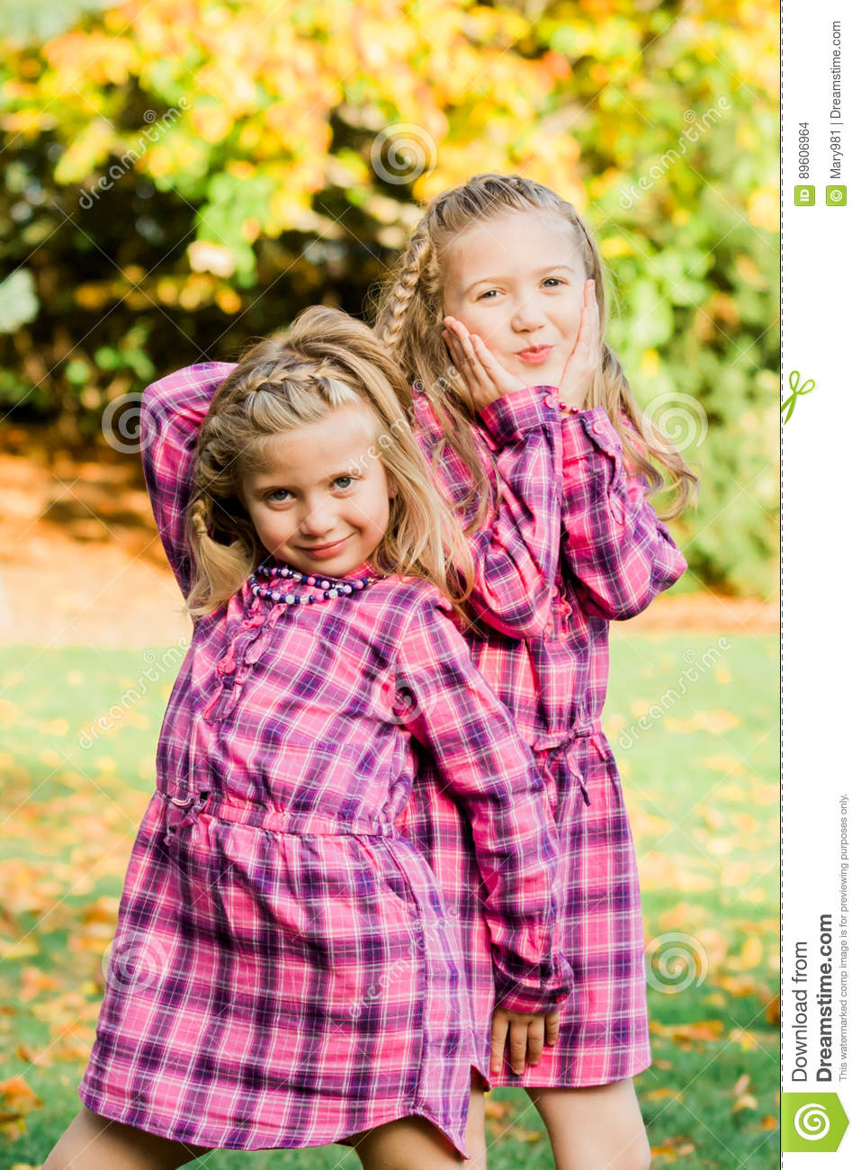 Two Young Caucasian Sisters