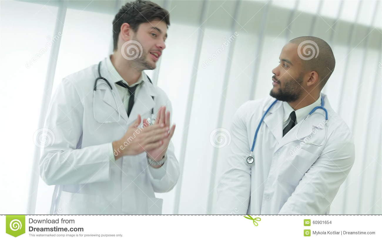 Two Young Doctors In Medical Gown Lively Debating Stock Footage ...
