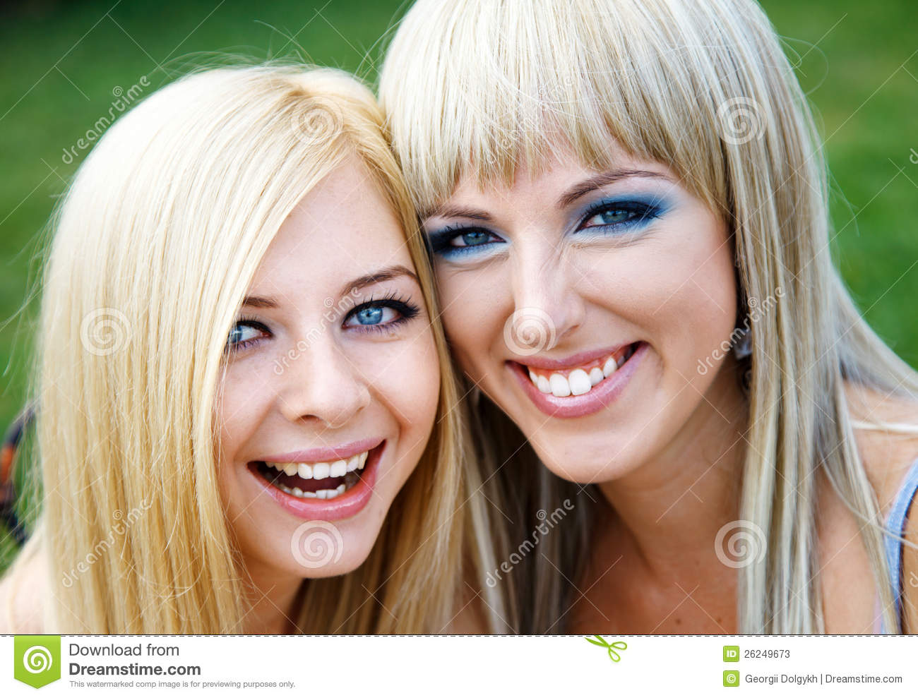 Two young girl friends in a park
