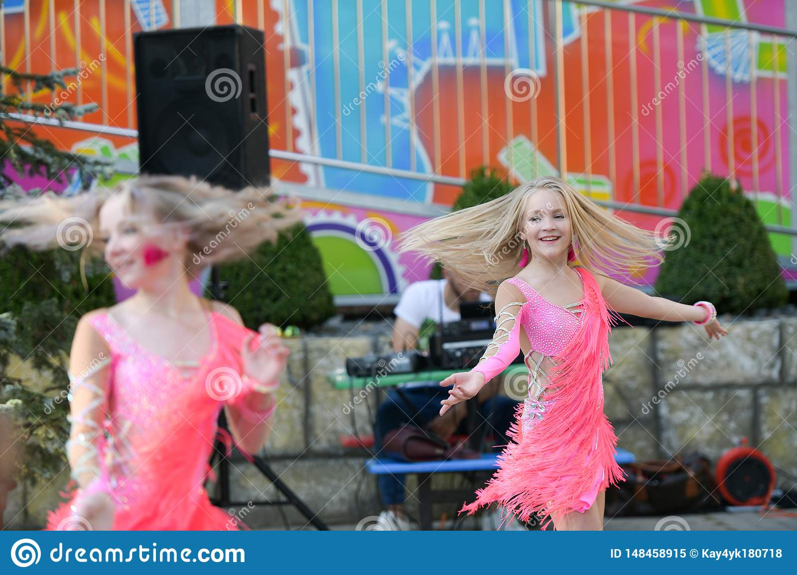 Two young girls dancing together. dancing with pleasure. open-air dance performance