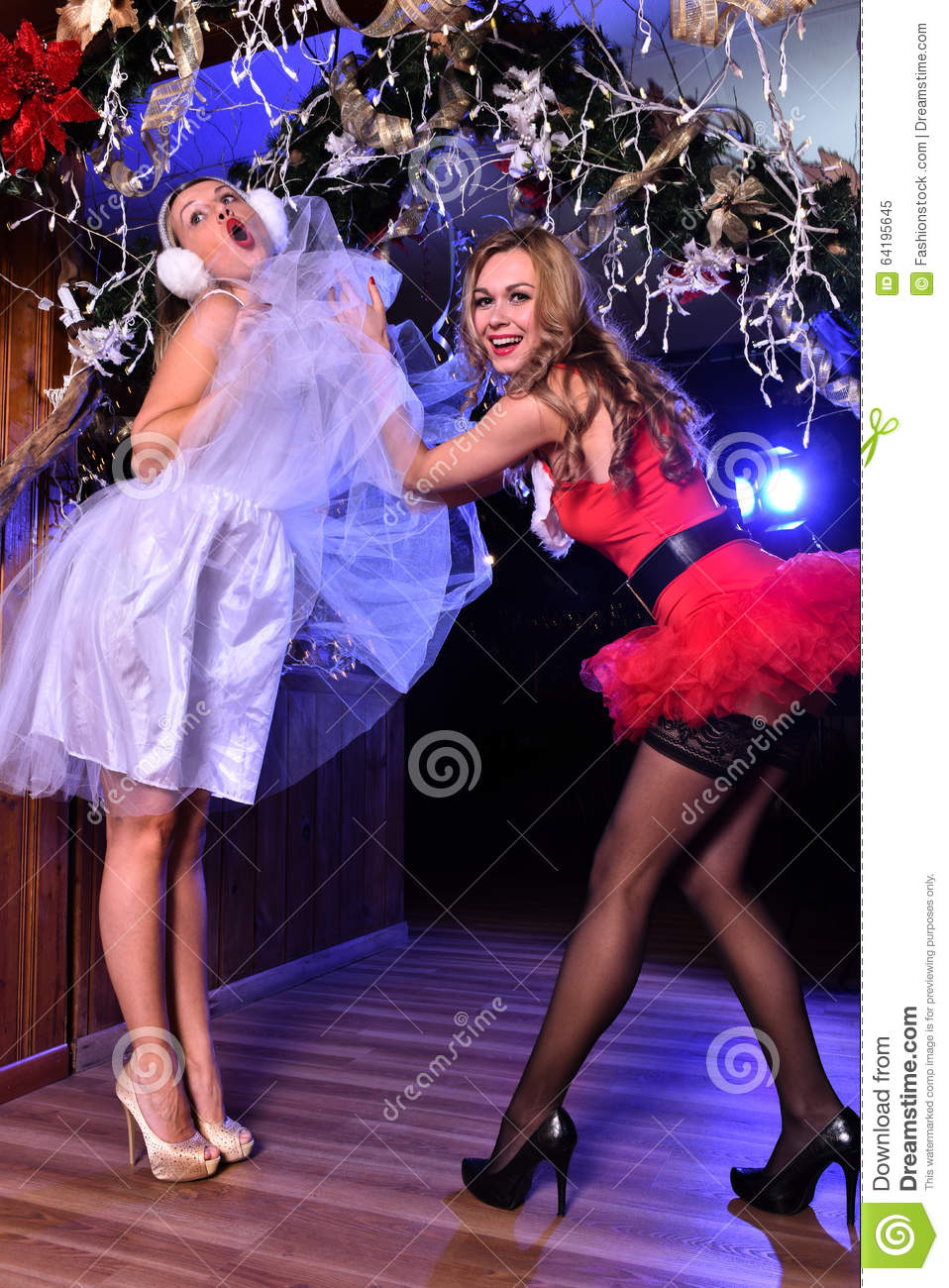 Two Young Girls Posing In Front Of Camera As Santa Helpers Stock Image - Image Of Girl -9755