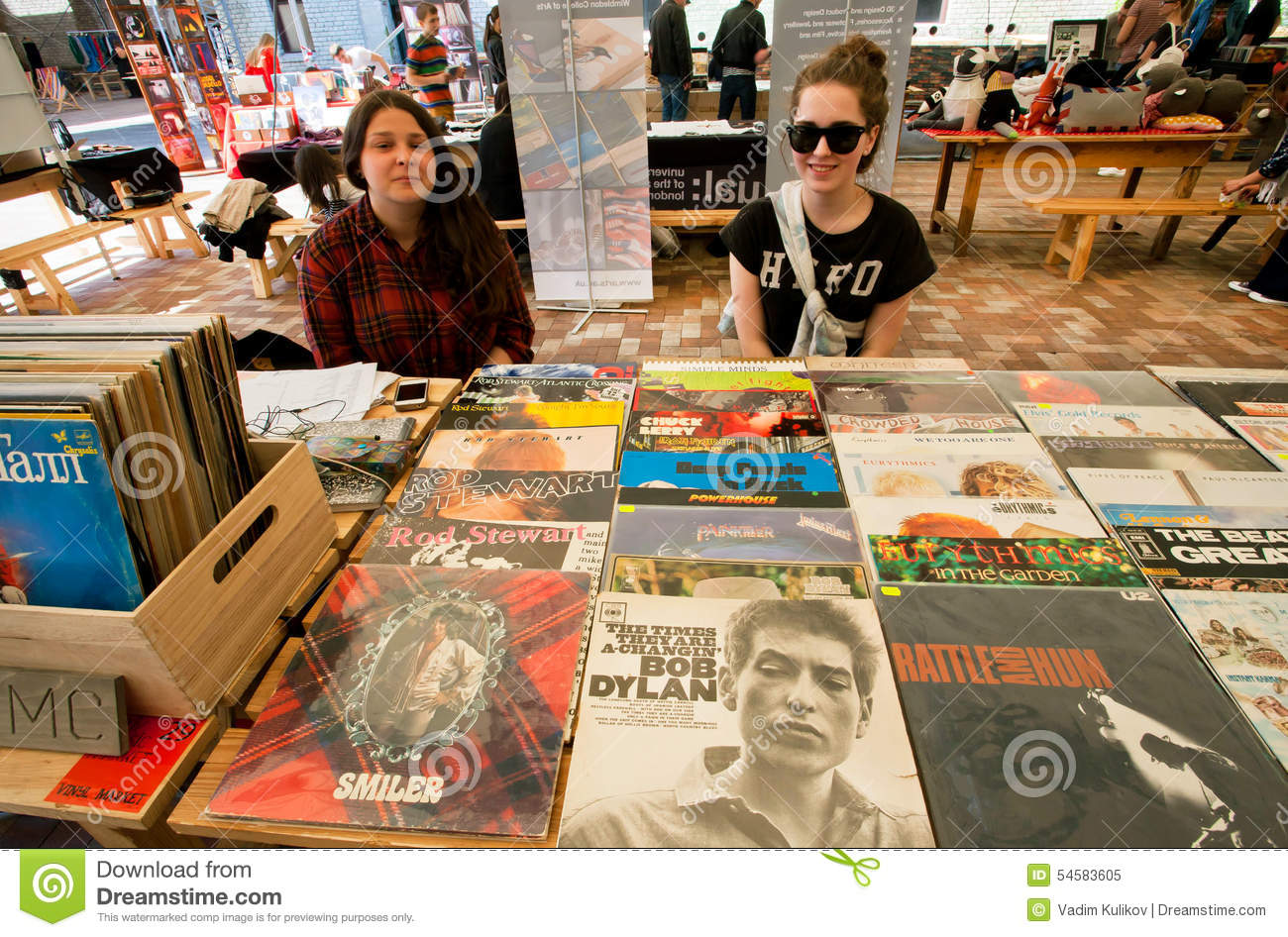 Two Young Girls Sell Vintage Vinyl Records Editorial Image