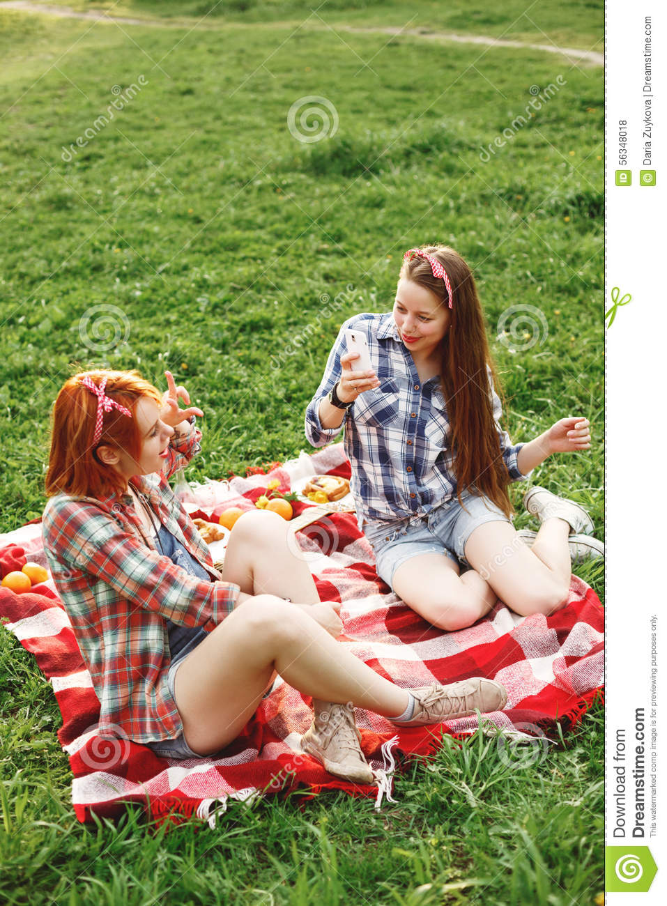 Two Young Happy Girls Taking Photos On Phone Stock Photo - Image 56348018-5965