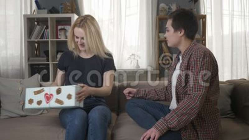 Two Young Lesbian Girls Are Sitting On The Couch, A Girl With Blond Hair Is  Pleased With The Gift, Hugs 60 Fps Stock Footage - Video of friends, ...