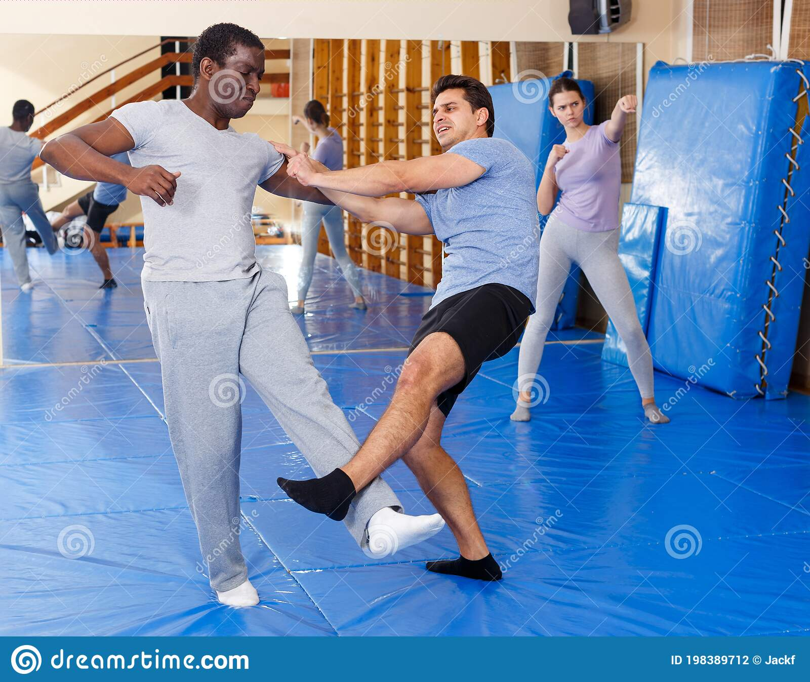 Two Men Practicing Self Defense Techniques Stock Photo Image Of Exercising Lady 198389712