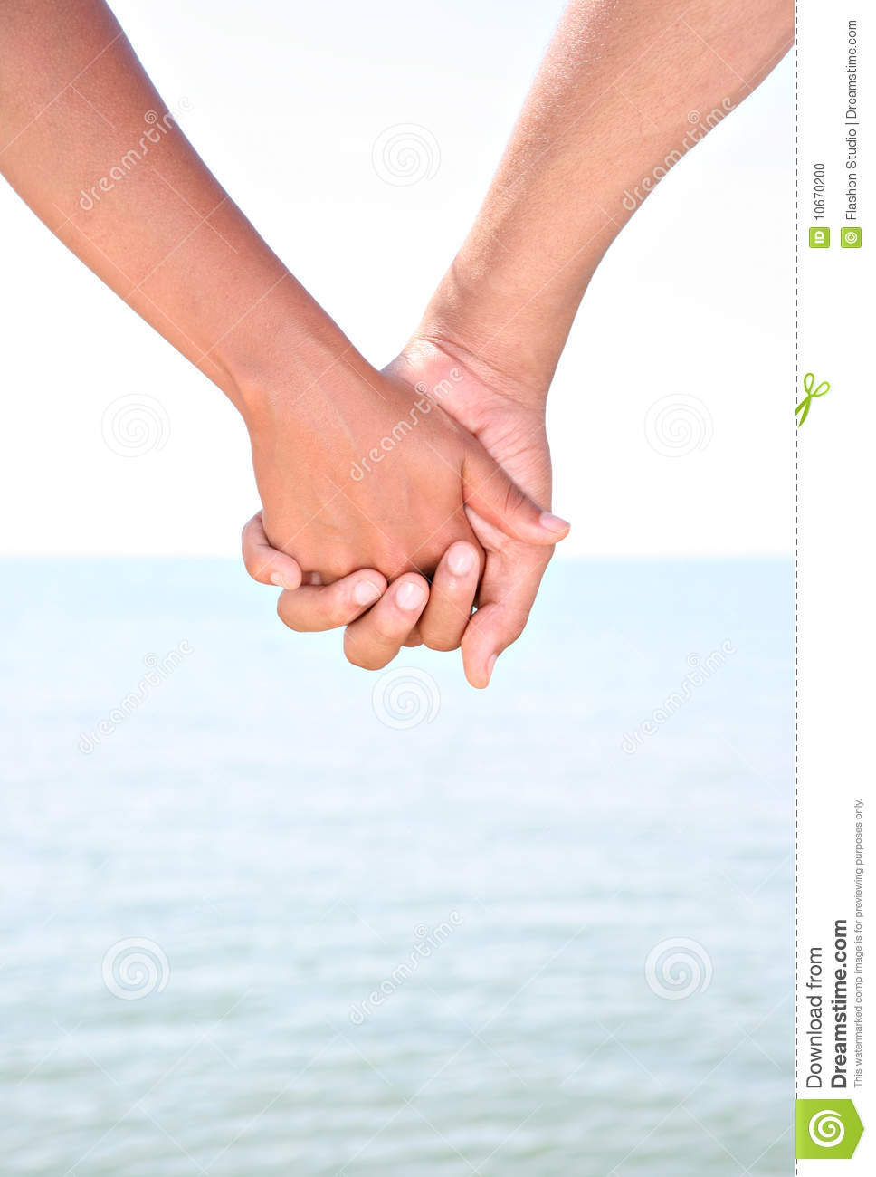 Two Young People Holding Hands By Water Stock Photo ...