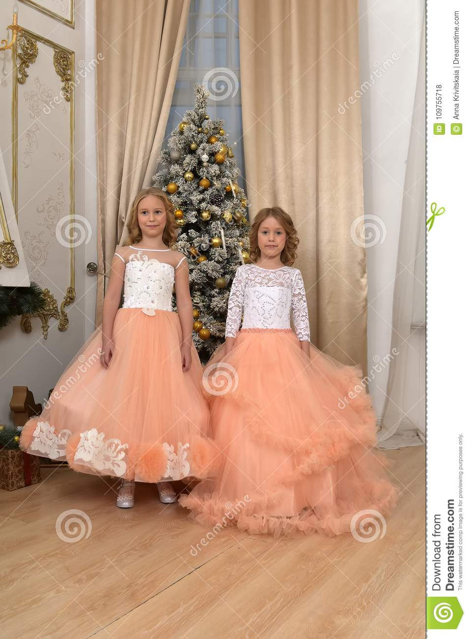 two young sisters in white with peach dresses