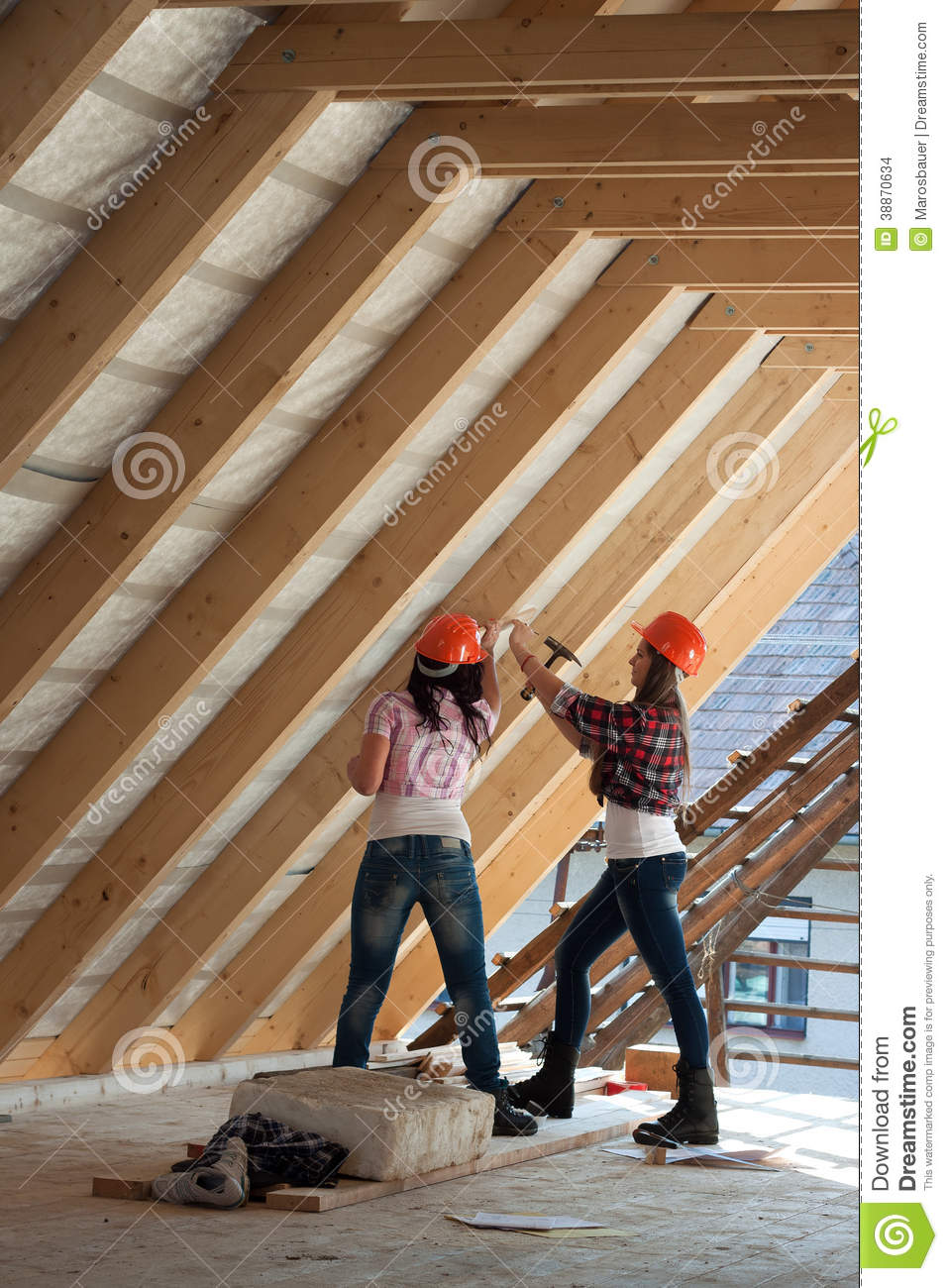 Two Young Woman Repairing The Roof Of The House Stock