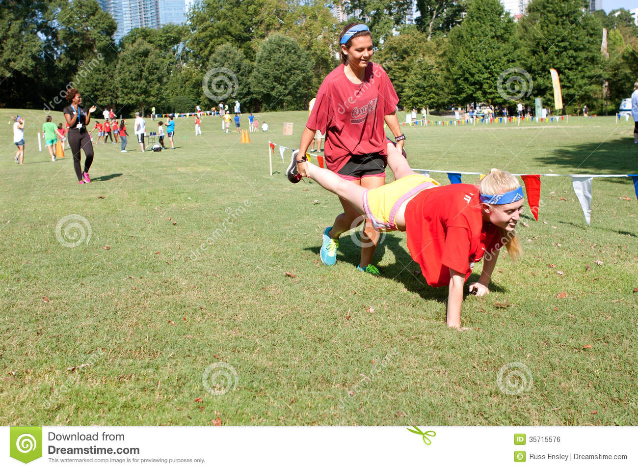 Two Young Women Compete In Wheelbarrow Race At Summer ...