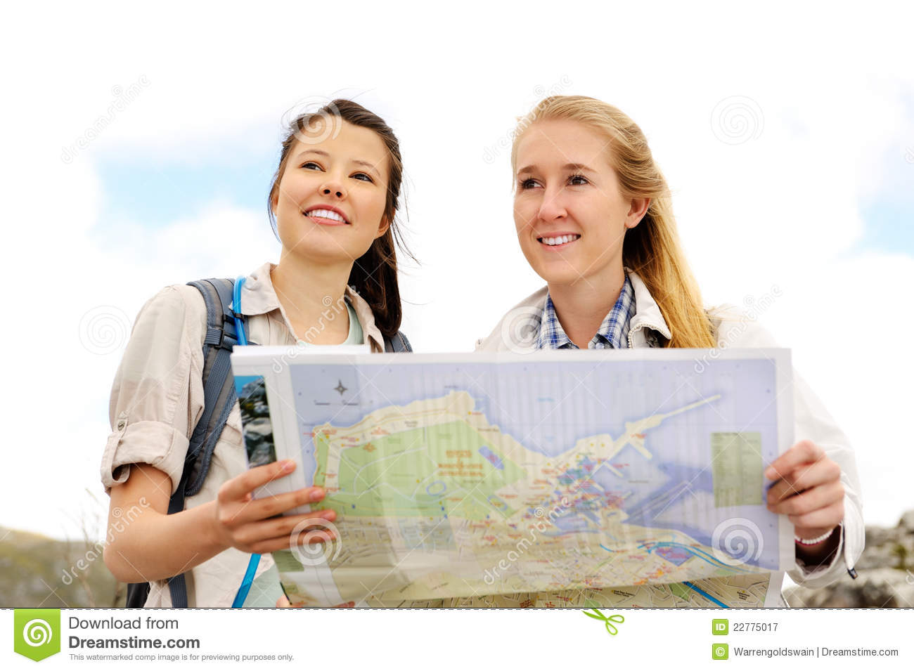 Two young women discussing the direction to take