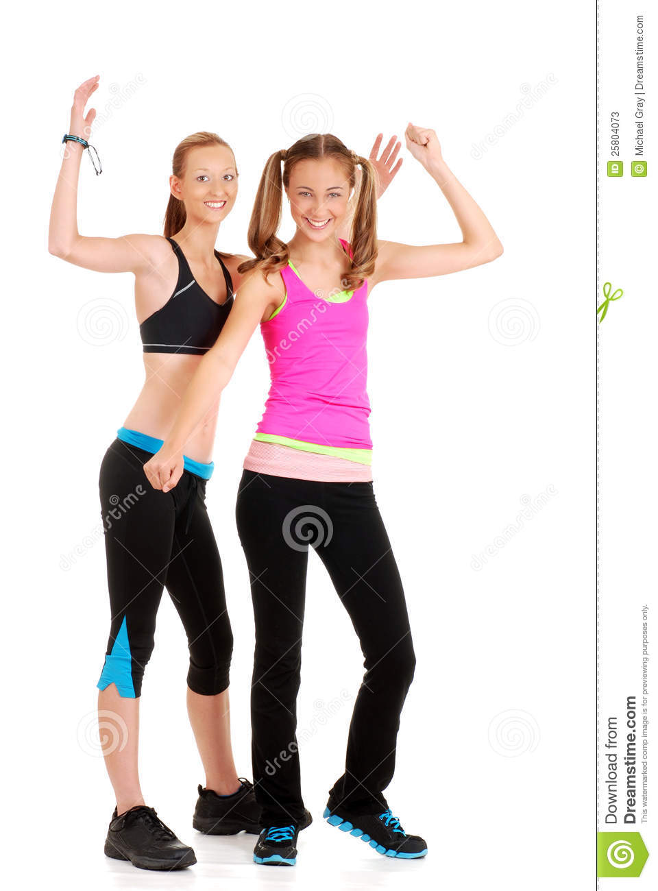 Two young women doing zumba fitness stock photos image