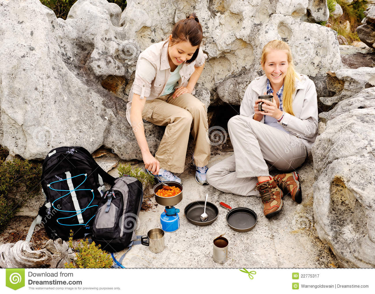 Two young women prepares something to eat