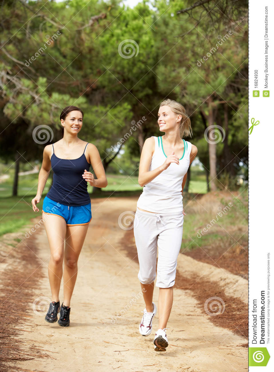 ceb2ec4b8b Two Young Women Running In Park Stock Photo - Image of outdoors ...