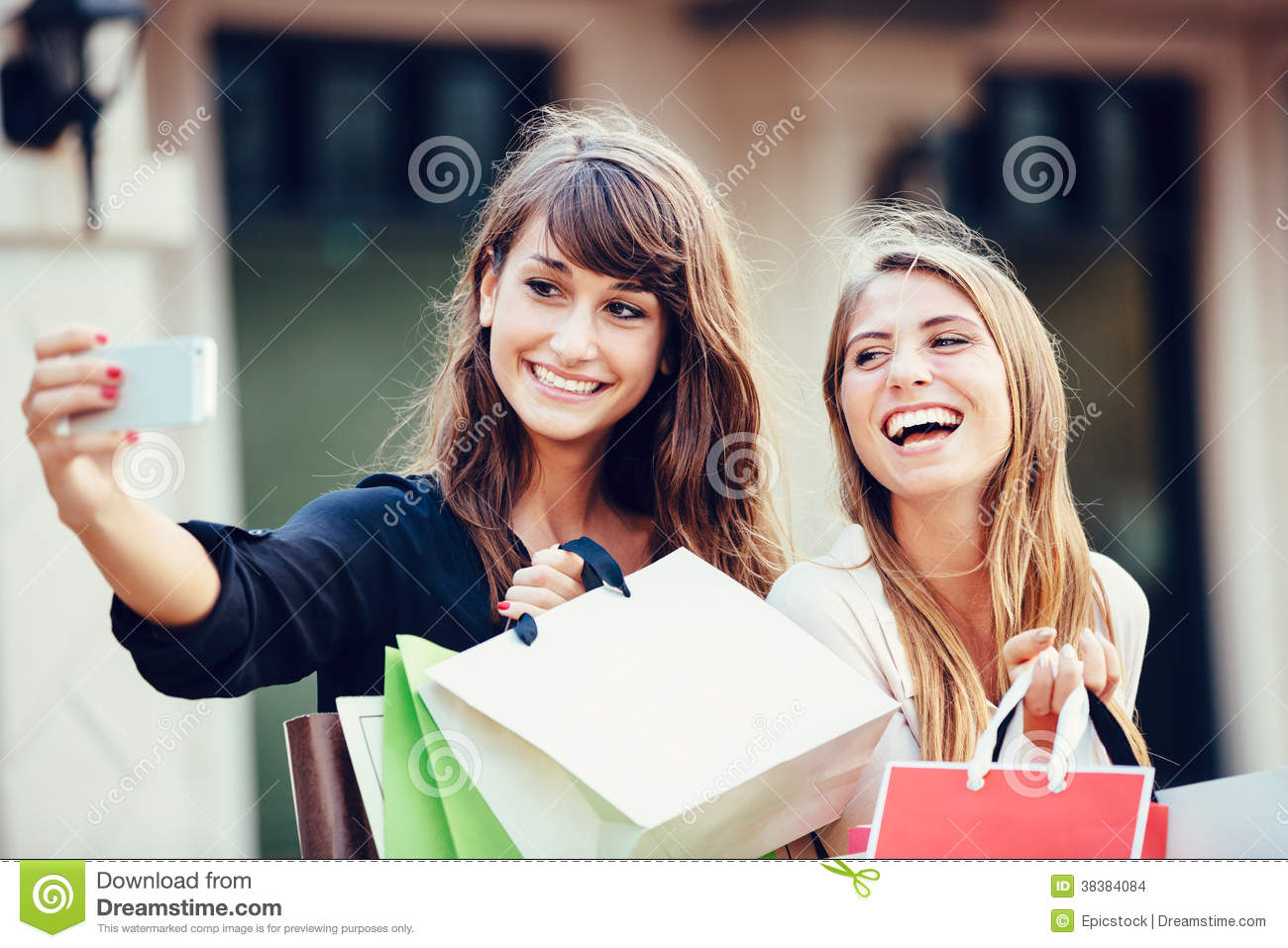 Two young women shopping at the mall taking a selfie