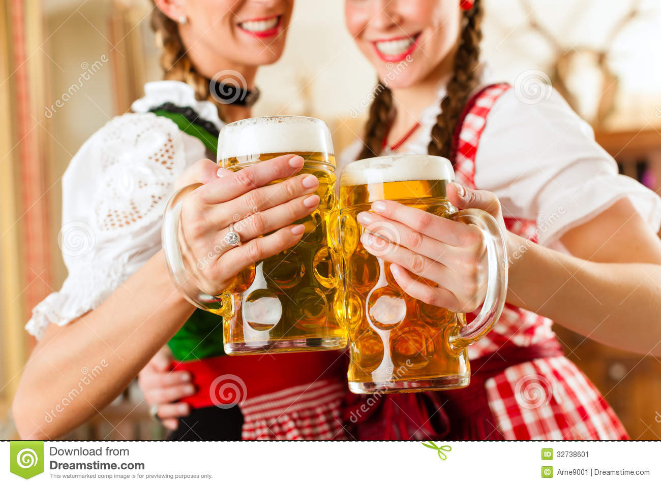 Two young women in traditional Bavarian Tracht in restaurant or pub
