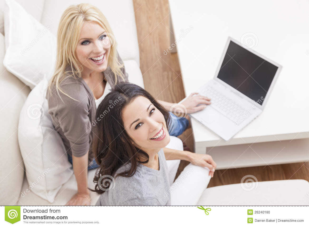 Two Young Women Using Laptop Computer Home Sofa
