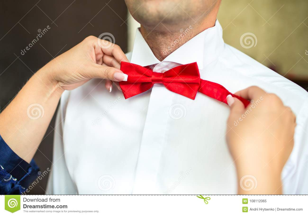 94db6c79 Tying a bow tie stock image. Image of fashion, ribbon - 108112065
