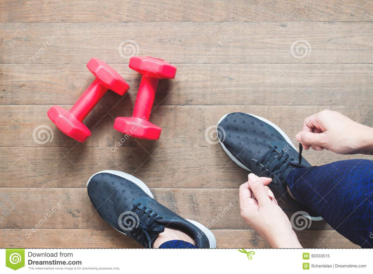 Tying sport shoes, Asian woman getting ready for weight training. Exercise, Fitness training. Healthy lifestyle