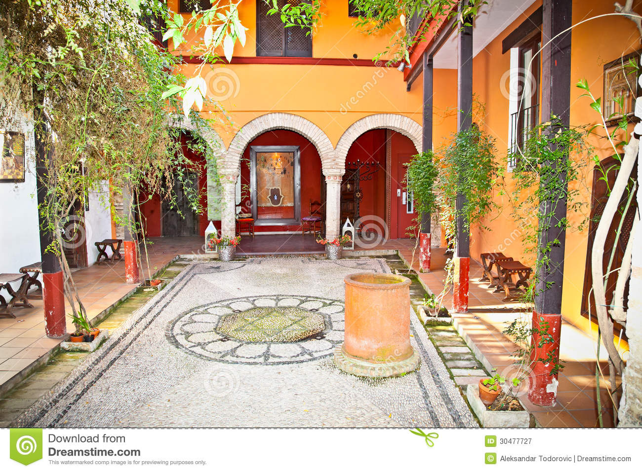 Typical andalusian courtyard in seville spain stock Seville house