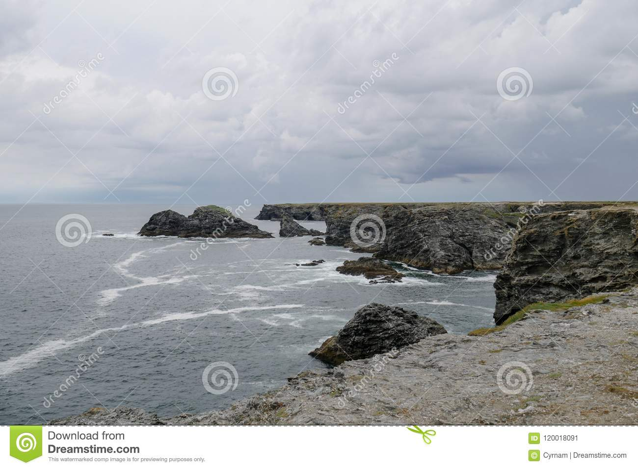Typical brittany coastline with grey cloudy sky and immensity of atlantic ocean