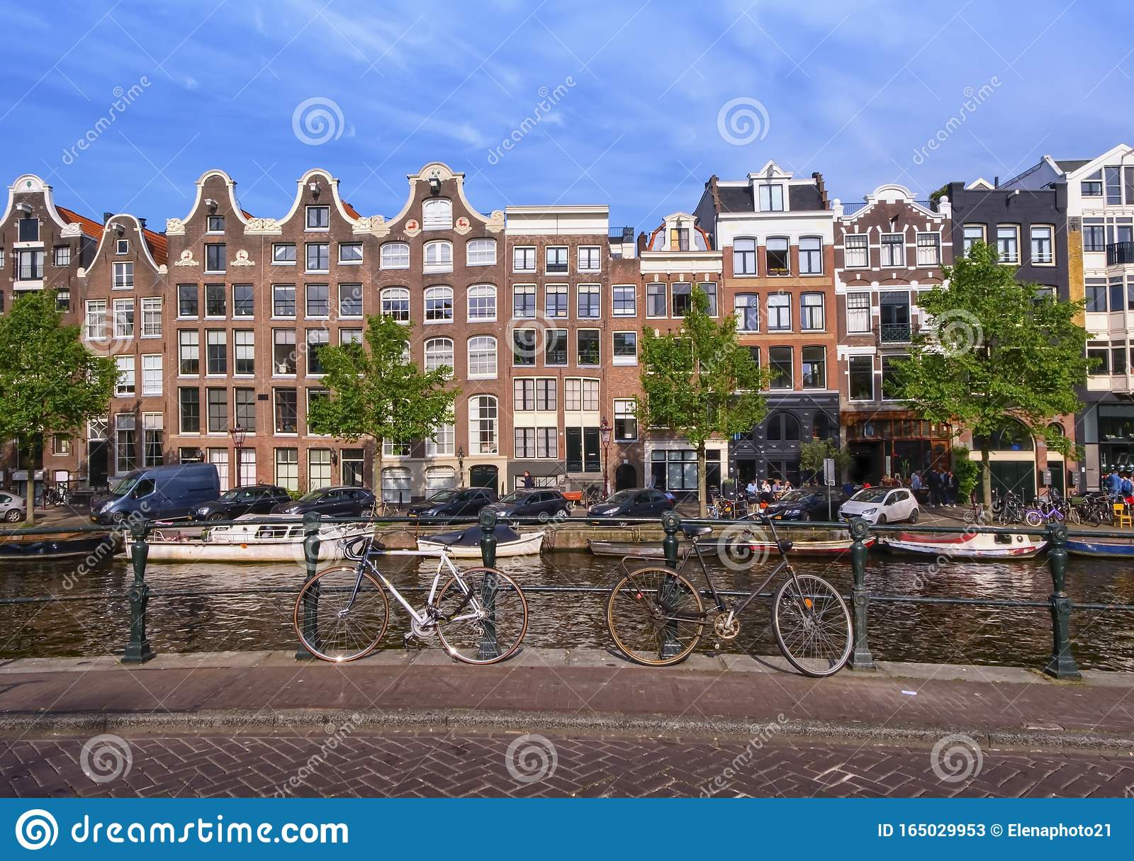Typical buildings, canal and bikes in Amsterdam, Netherlands