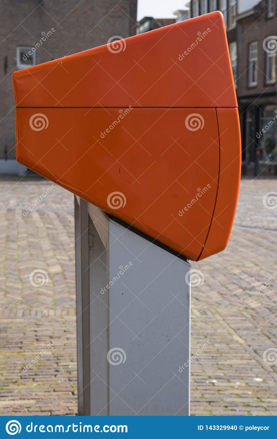 Typical Dutch orange letter box in street