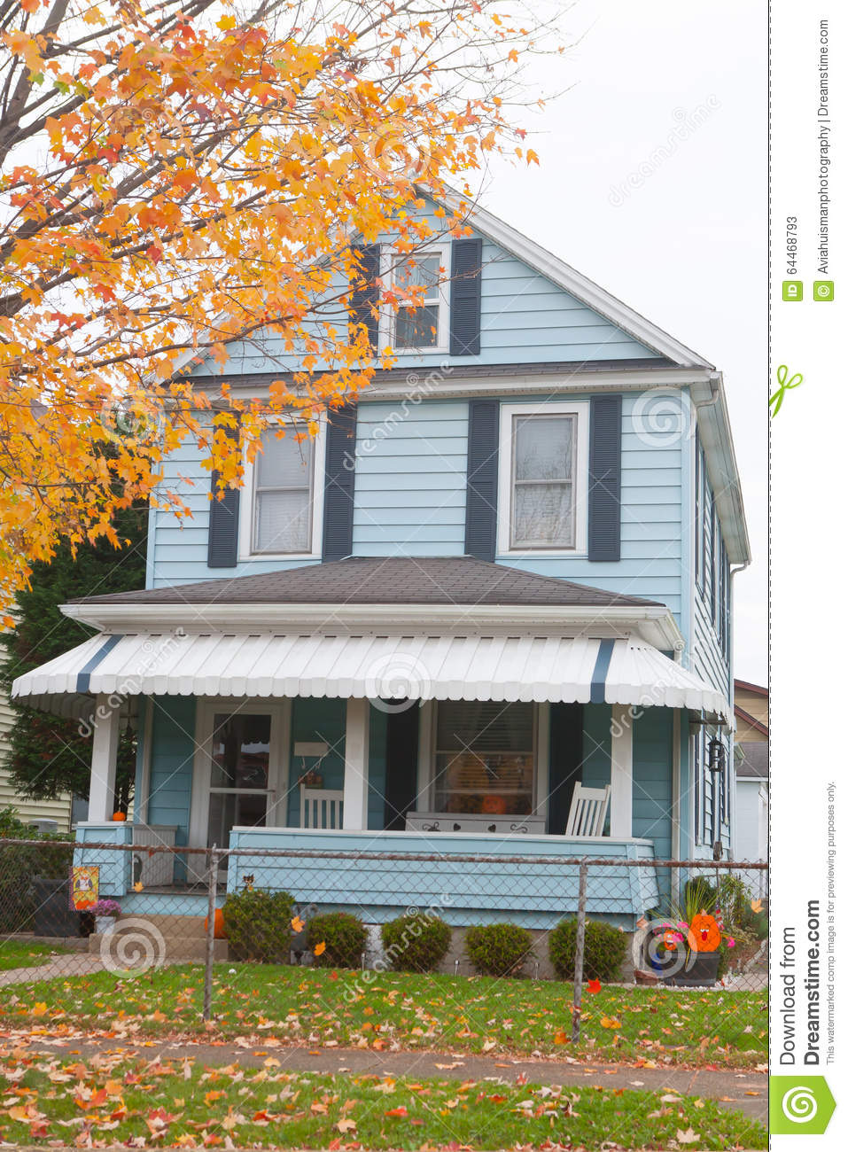 Typical family home blue siding and halloween decor stock for Blue siding house