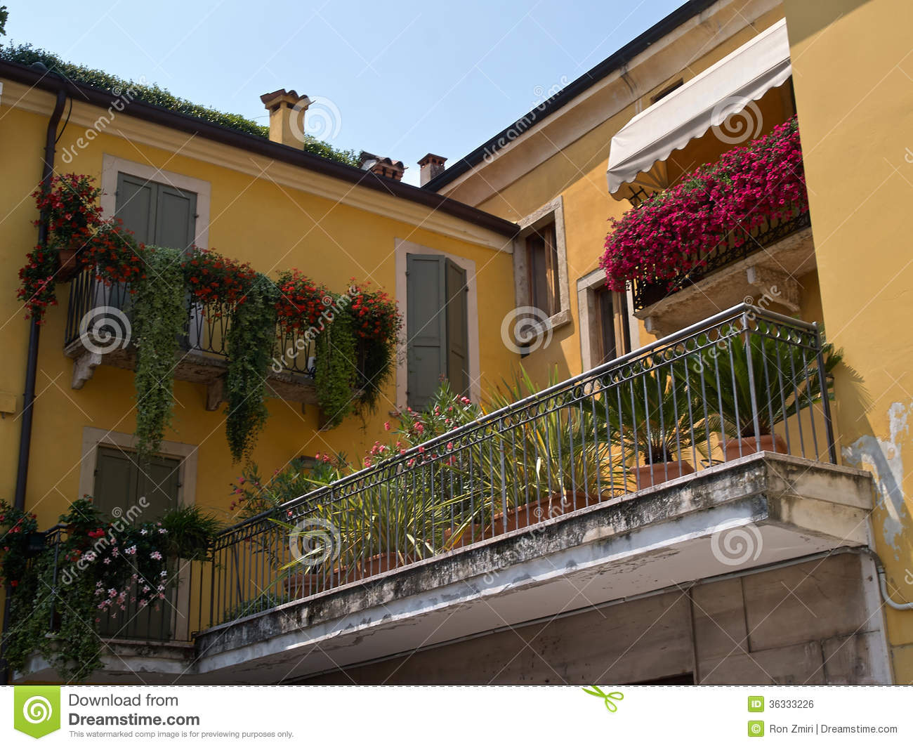 Italian House Of Typical Italian House Balcony With Flowers Stock Photo