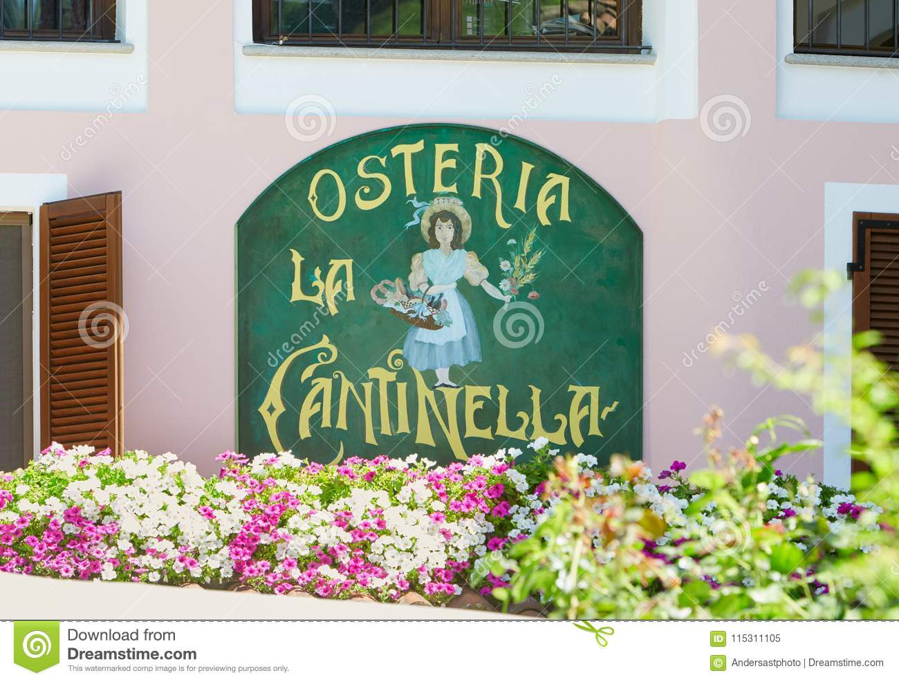 Typical Italian Restaurant Sign With Flowers In A Sunny Day