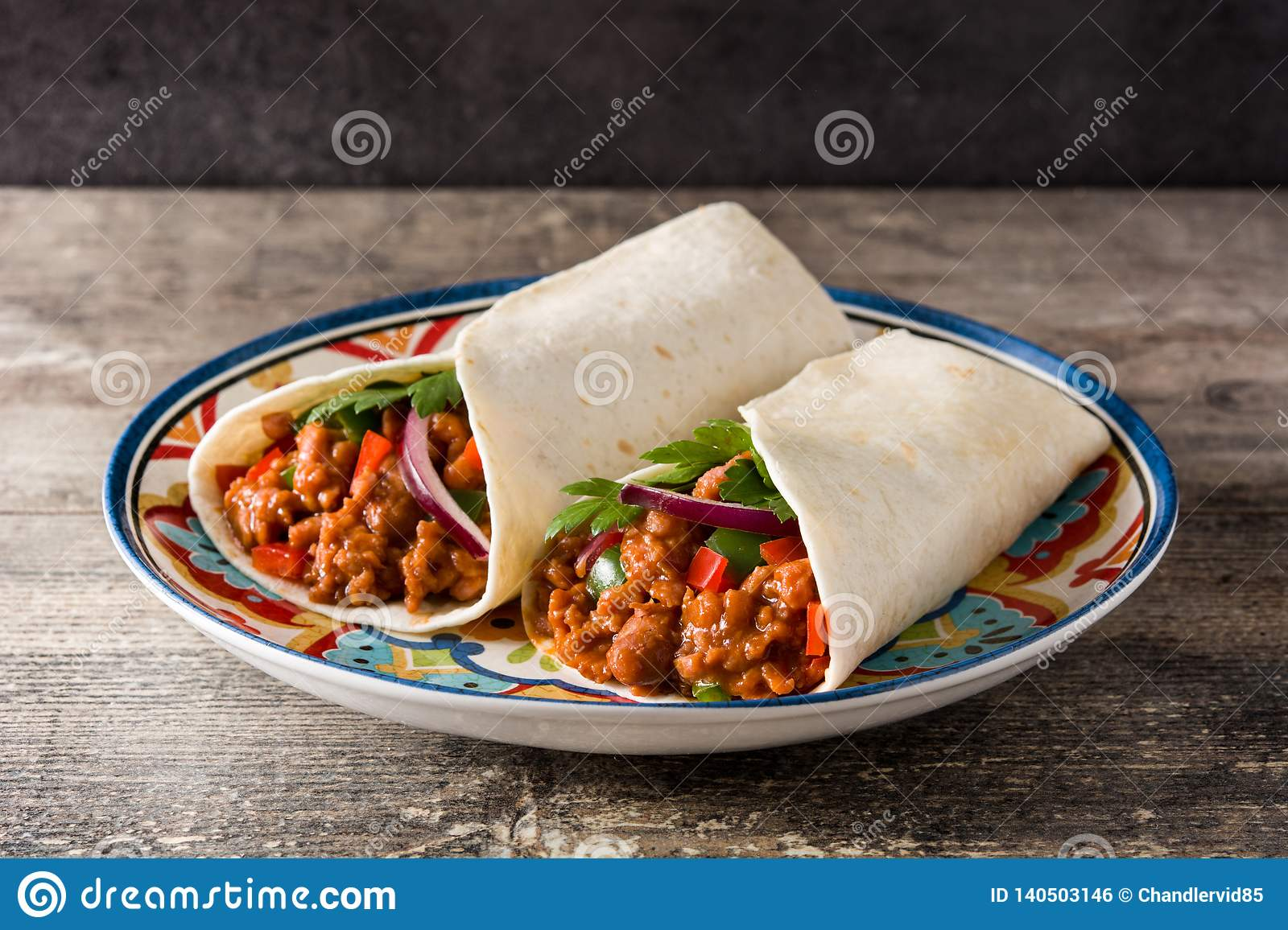 Typical Mexican burrito wrap with beef, frijoles and vegetables