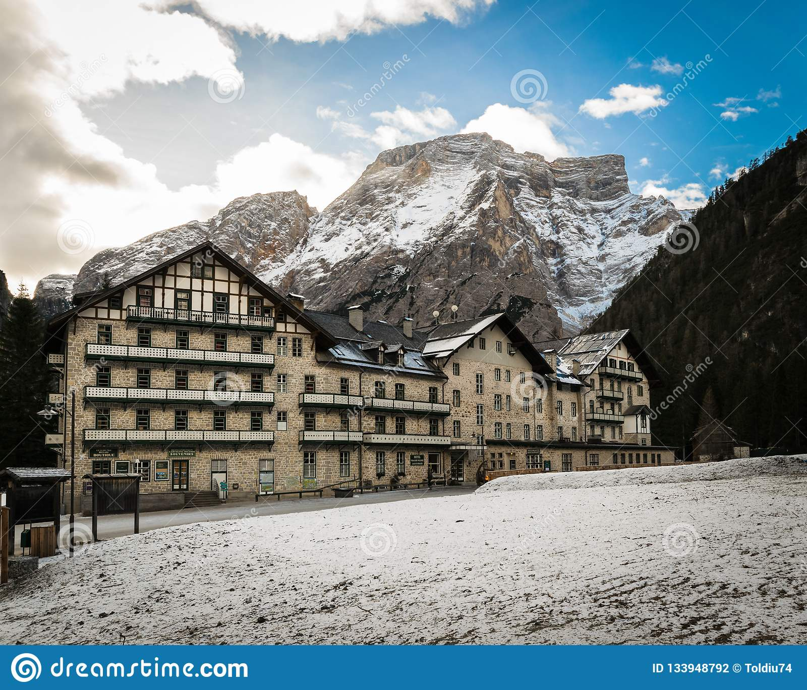 Typical mountain architecture and snowy mountain range in the ba