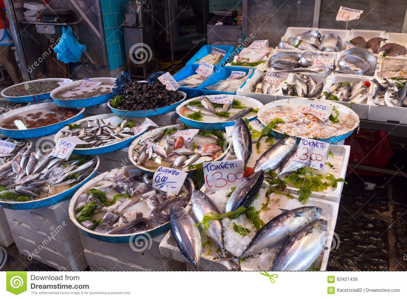 Typical outdoor italian fish market with fresh fish and for Seafood fish market
