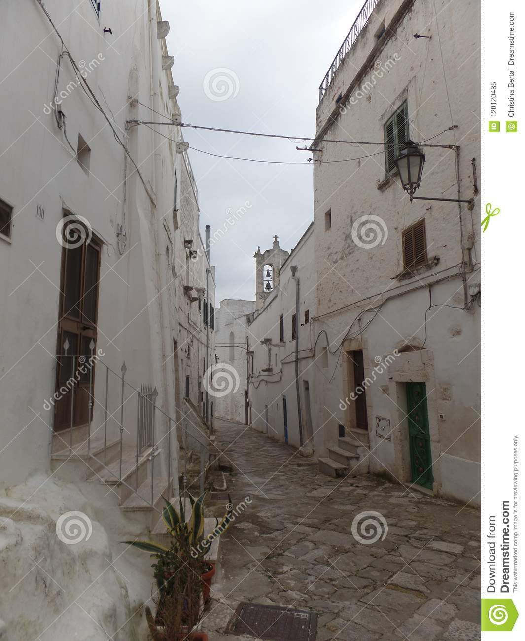 Typical street of white washed houses in Ostuni, Puglia, Italy