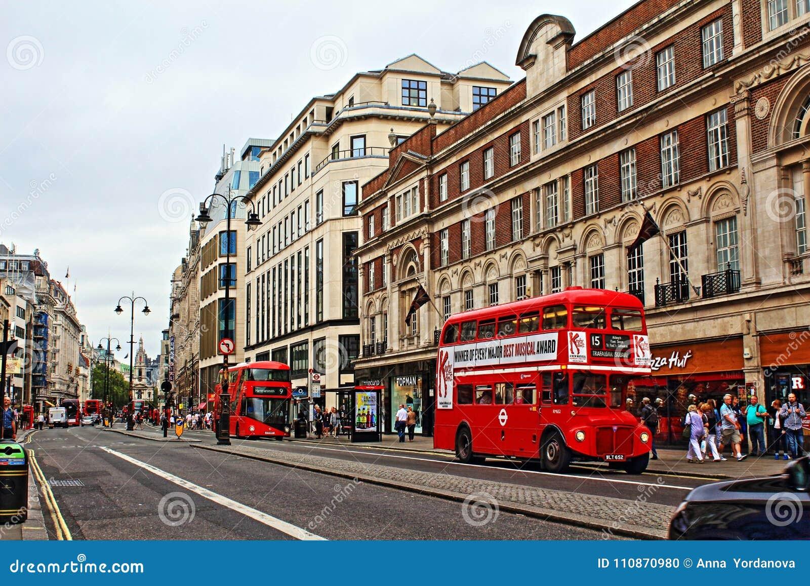 Red buses on Strand London England United Kingdom