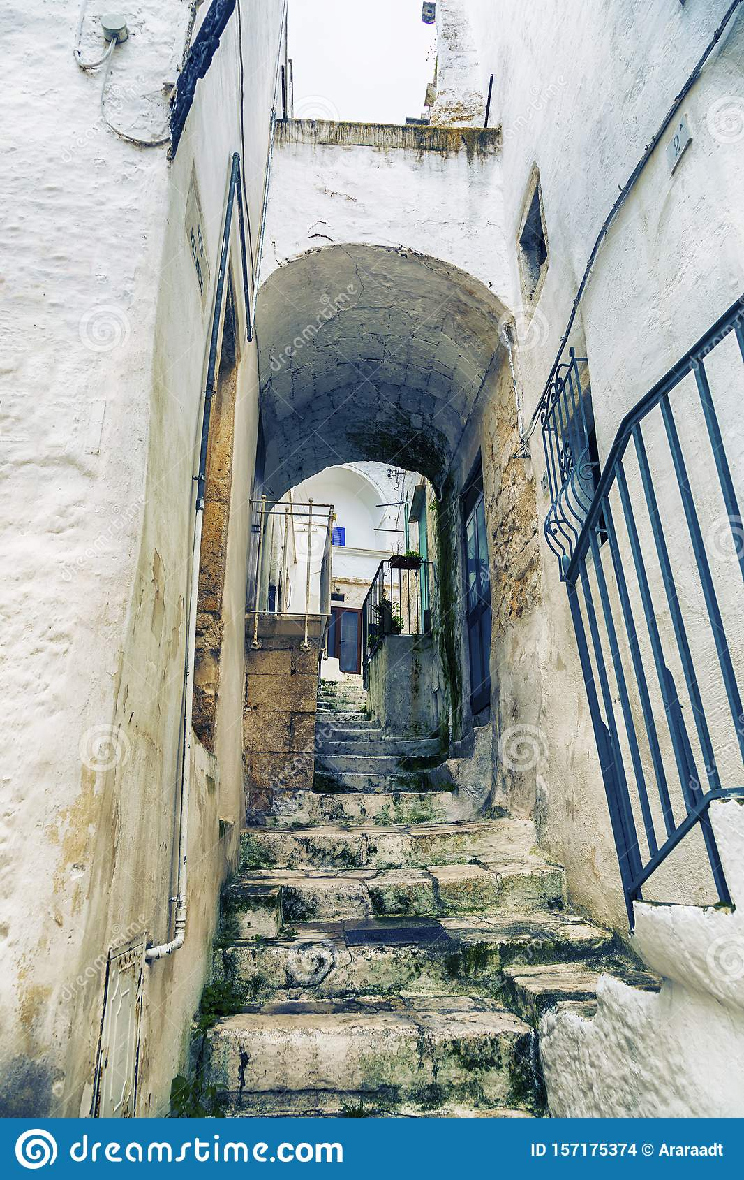 Small street in Ostuni - ancient white town in Italy