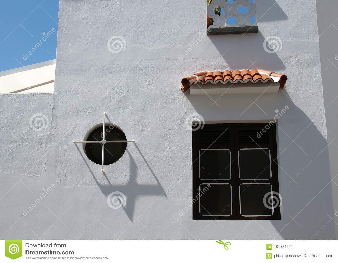 Typical spanish white house in tennerife with black windows