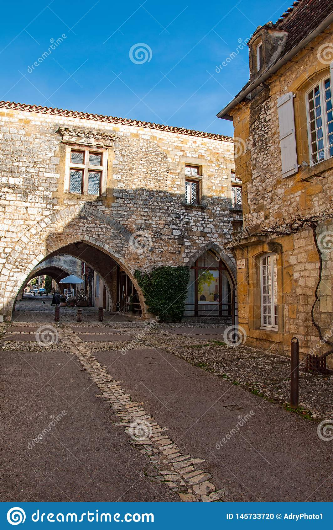 The village of Monpazier, in the Dordogne-Périgord region, France. Medieval village with arcades and typical square