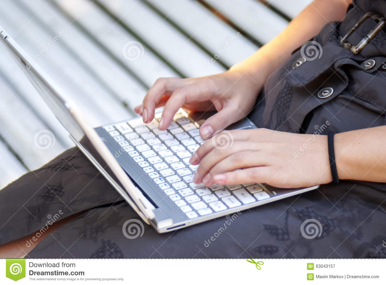 Typing on notebook...