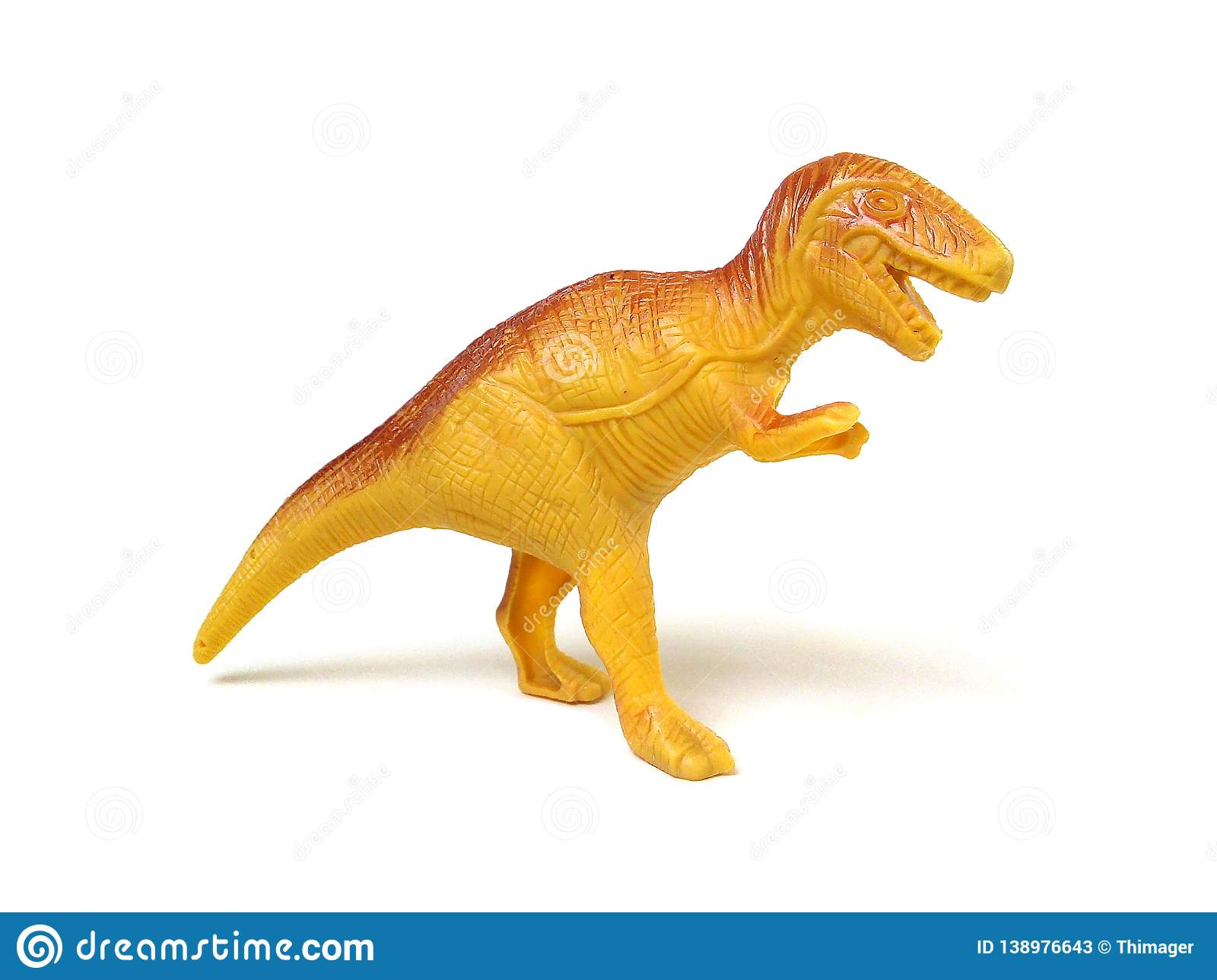 Tyrannosaurus rex or t-rex dinosaur toy. Close up of brown plastic dinosaur toy isolated on white background stock photos
