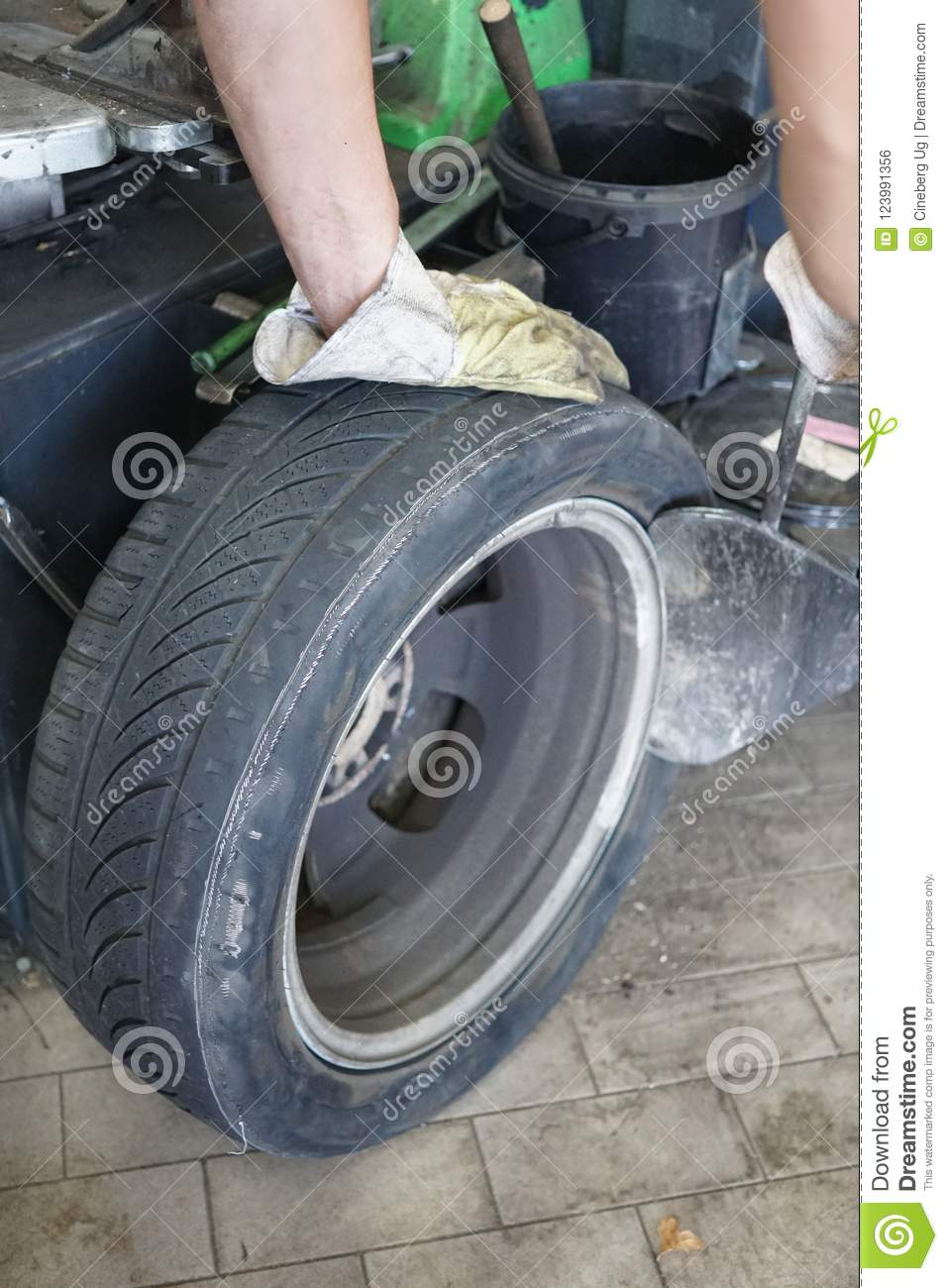 Download Tyre Changing In An Auto Repair Shop Stock Photo