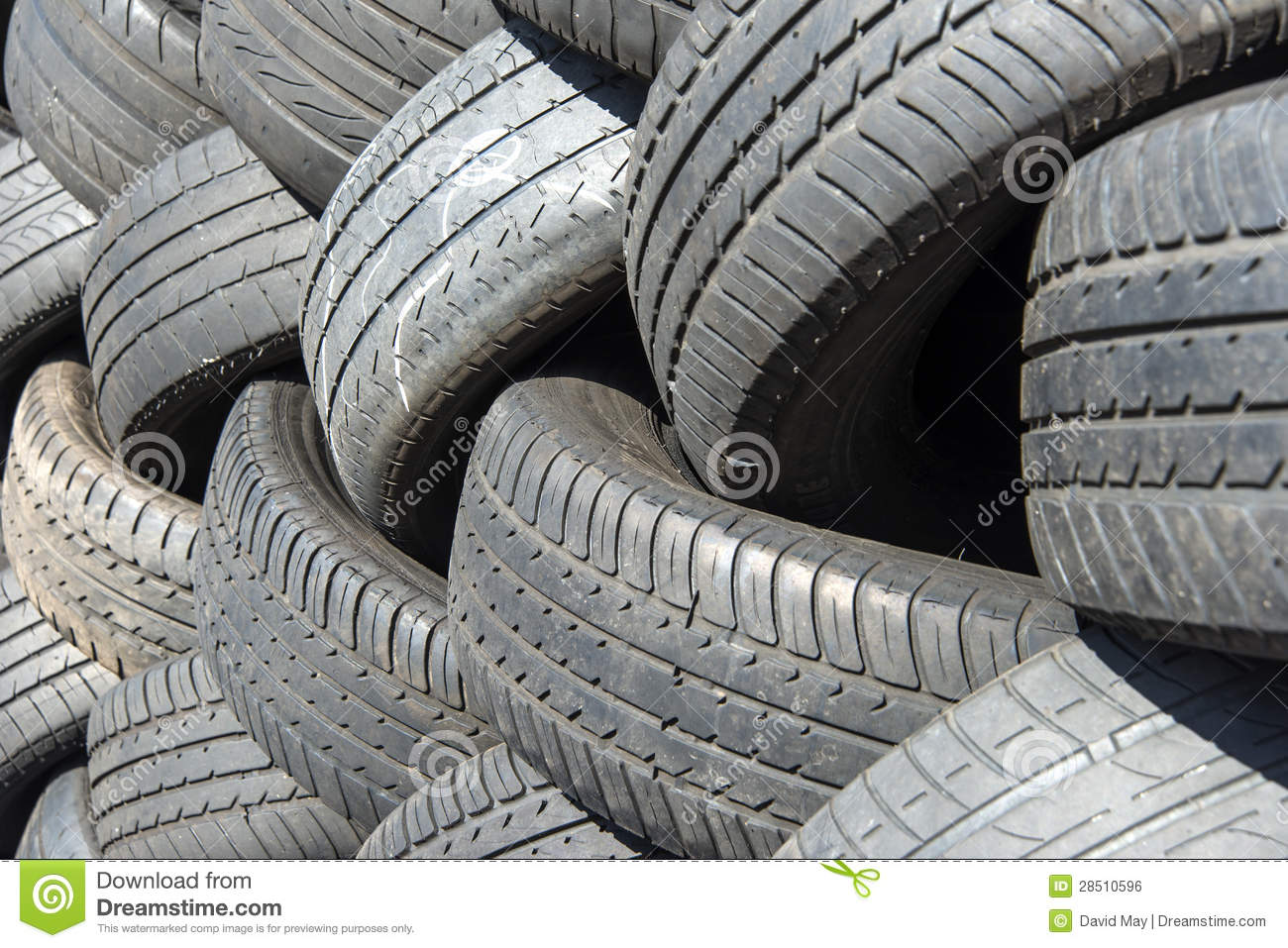 Pile of used rubber tyres on gray background royalty free for Old tyre uses