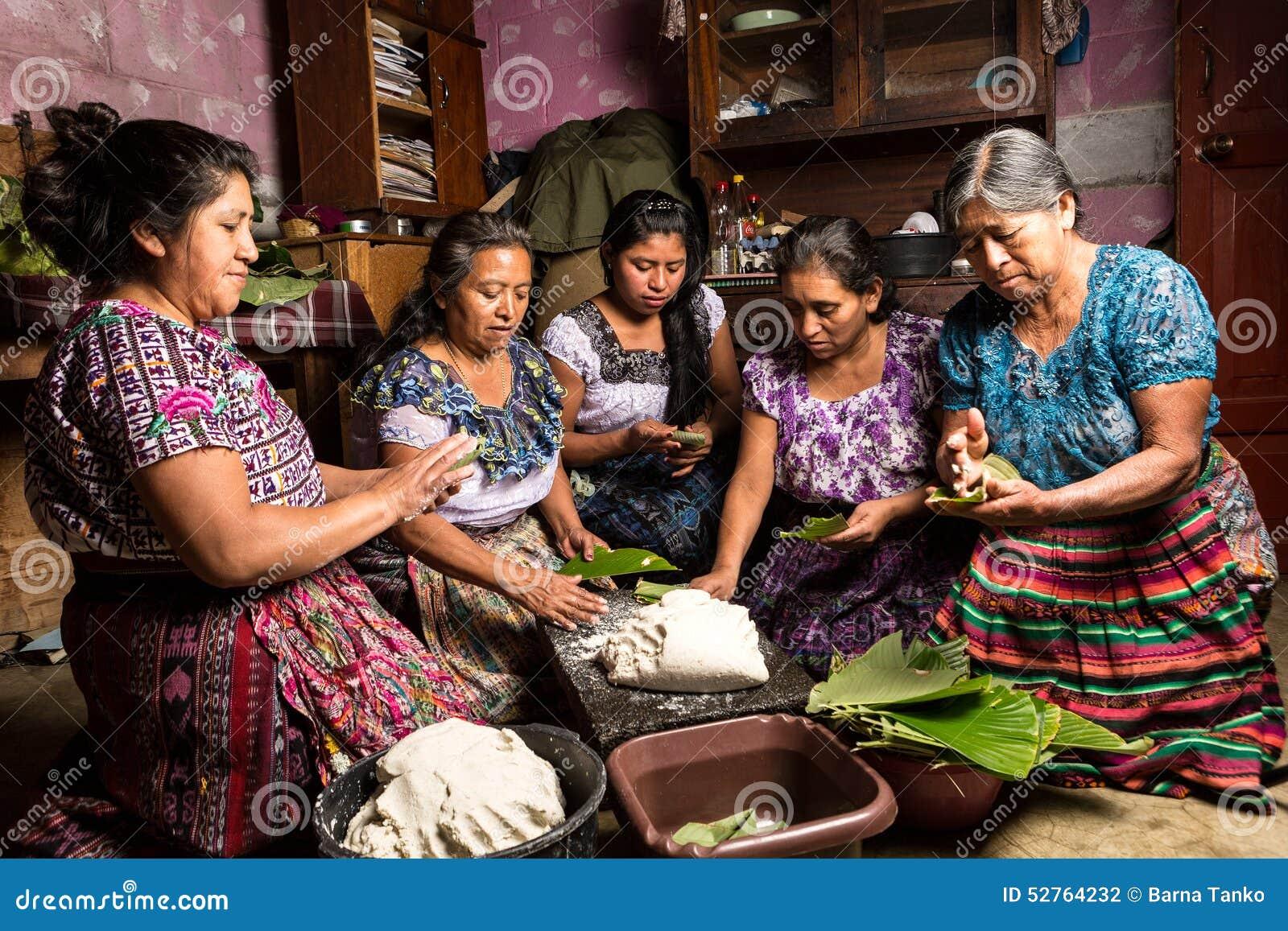 Tzutujil Maya Womwn Preparin Traditional Food In Guatemala