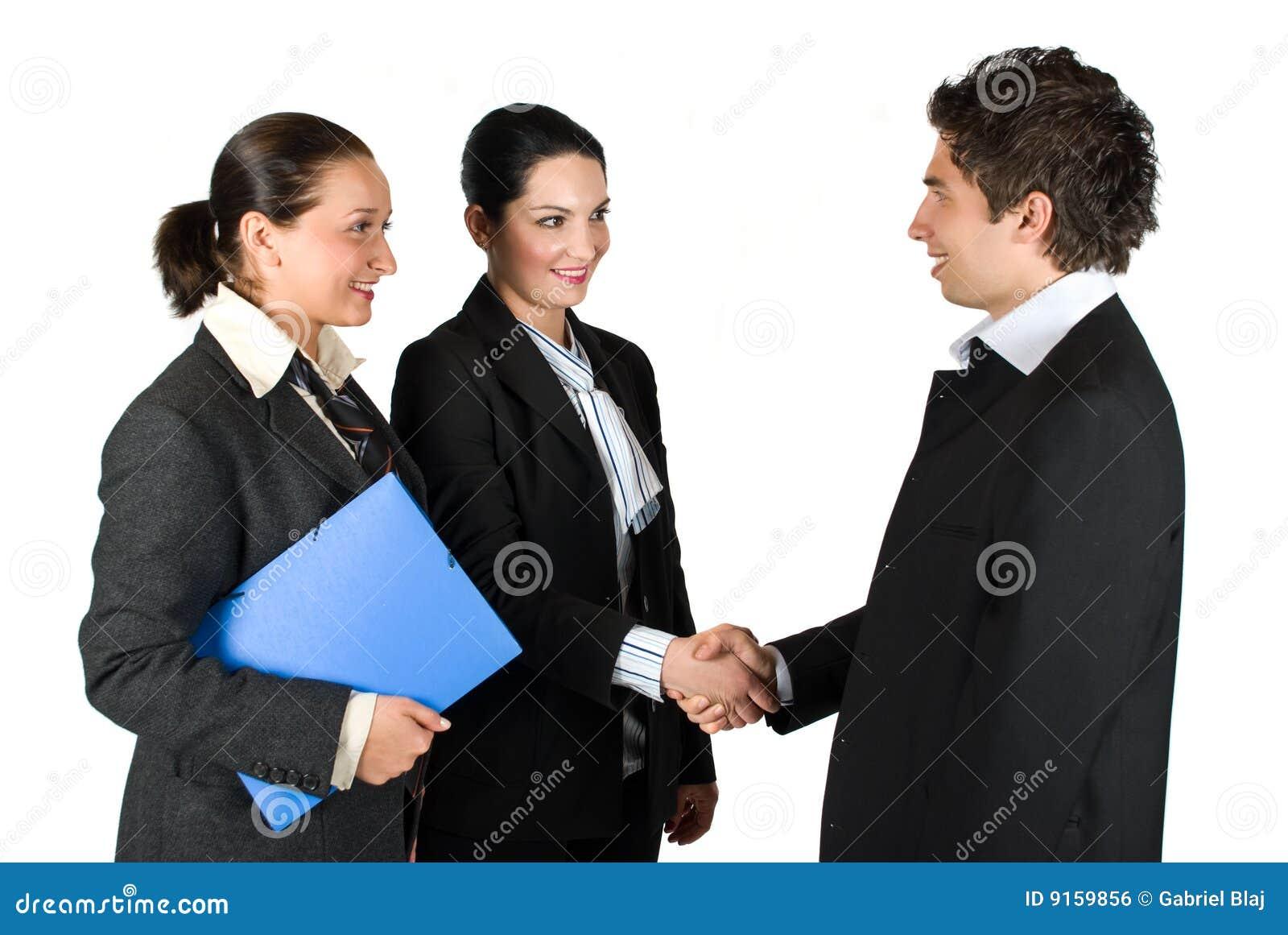 Uścisk dłoni i spotkania ludzie biznesu
