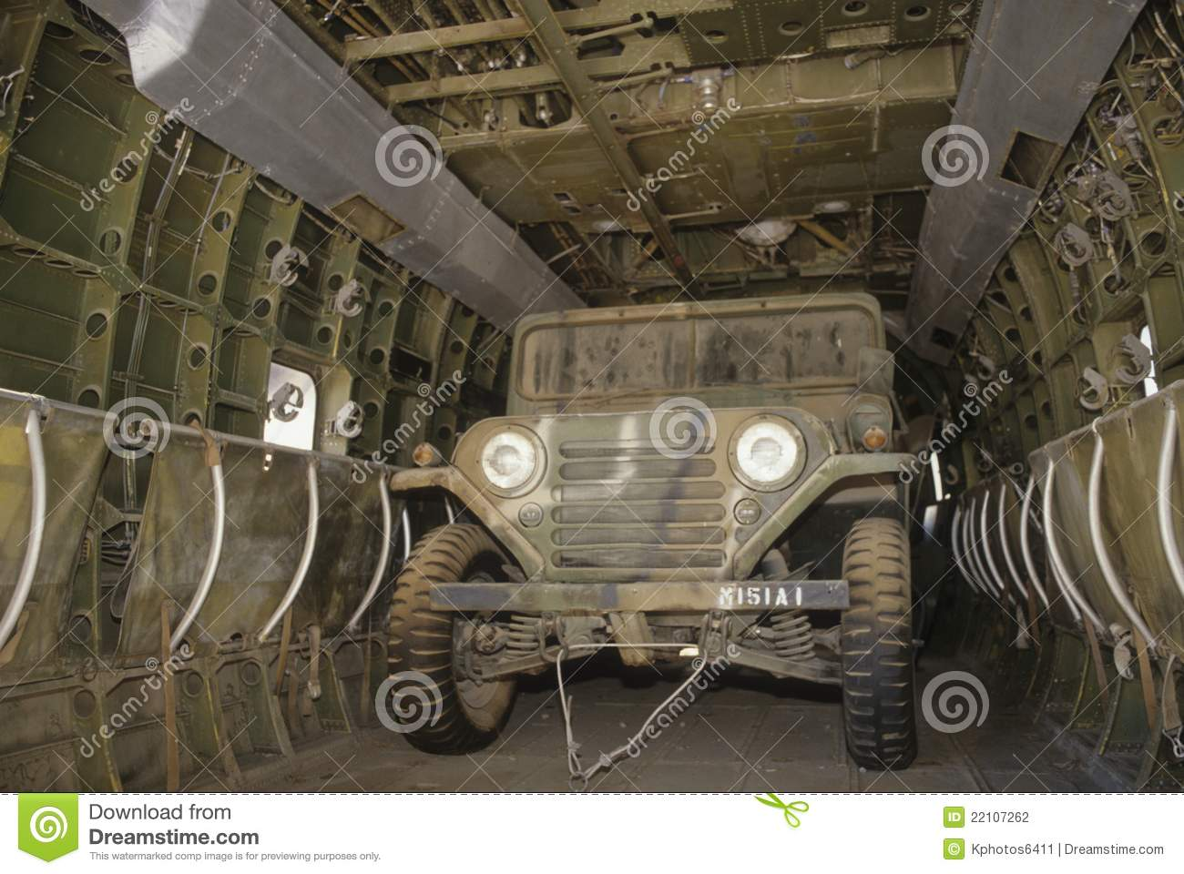 US Army Jeep Inside Helicopter Staged For Transport Cargo