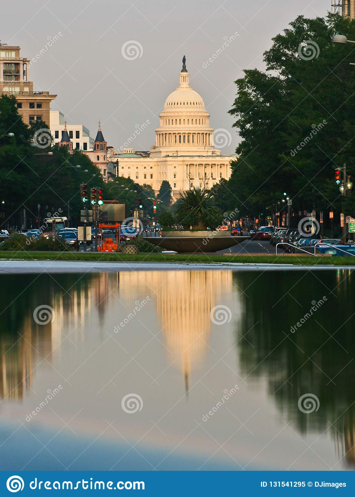 U.S. Capital Building reflection on street fountain. June 2006