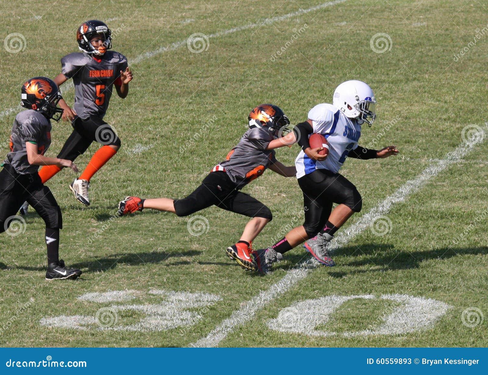 11u youth football runner on 30 yard line